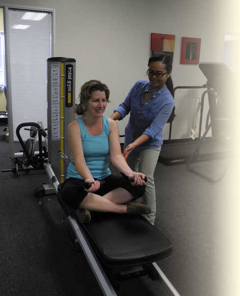 Client performing pilates exercise