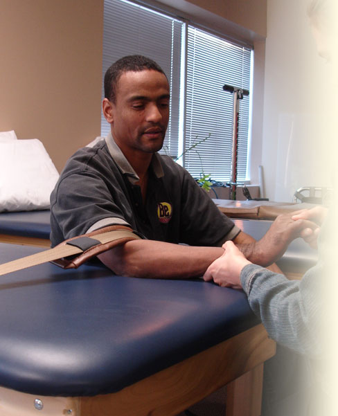 Client obtaining hand therapy